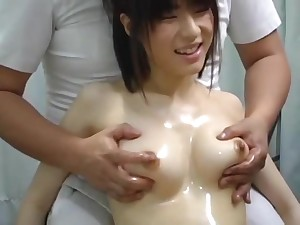 Young Japanese Pet Received A Tit Massage