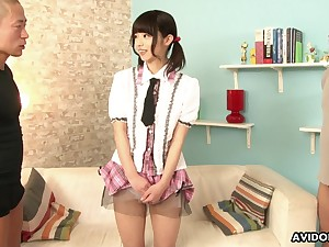 Lovely pigtailed young lady Akina Sakura flashes her nicely shaved pussy to dudes
